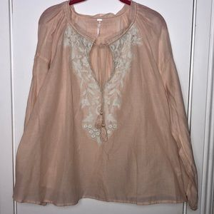 NWT Free People peach colored top size Med.